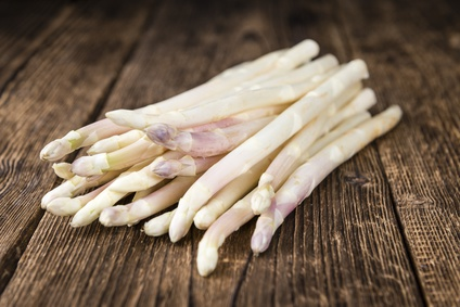 White Asparagus (selective focus) on wooden background