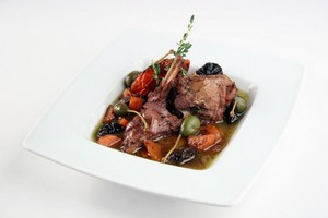 Stewed rabbit with tomato, pepper, carrot, prune, capers