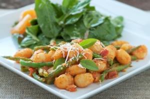 Delicious homemade gnocchi with fresh garden greens
